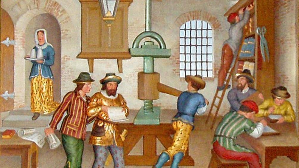 Een kijkje in de werkplaats van een boekdrukker in de 17e eeuw (foto: Wikimedia)