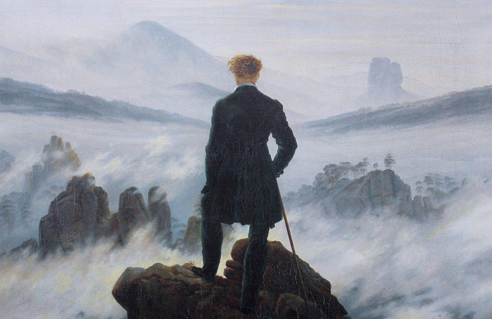 Wandelaar boven een zee van wolken