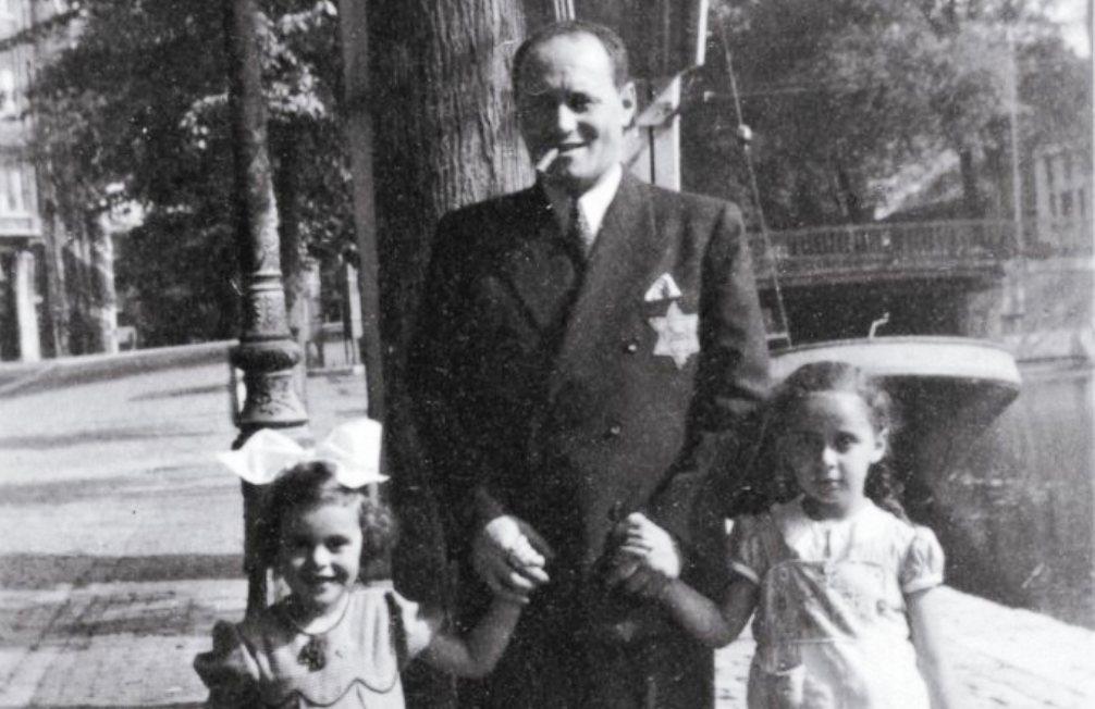 Walter Süskind met zijn dochtertje Yvonne en een vriendinnetje op de Prinsengracht 51 in Amsterdam, na mei 1942. Collectie Herinneringscentrum Kamp Westerbork.