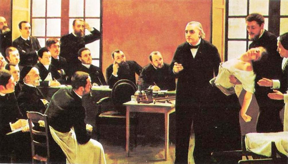 In een ziekenhuis in Parijs demonstreert een arts in 1887 aan een groep leerling-artsen het gebruik van hypnose op een 'hysterische' vrouwelijke patiënt. (Foto: Wikimedia)